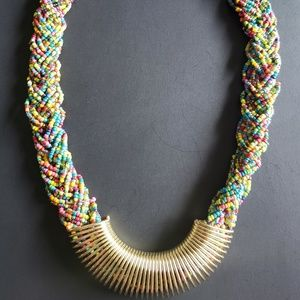Beaded necklace with gold-tone accents
